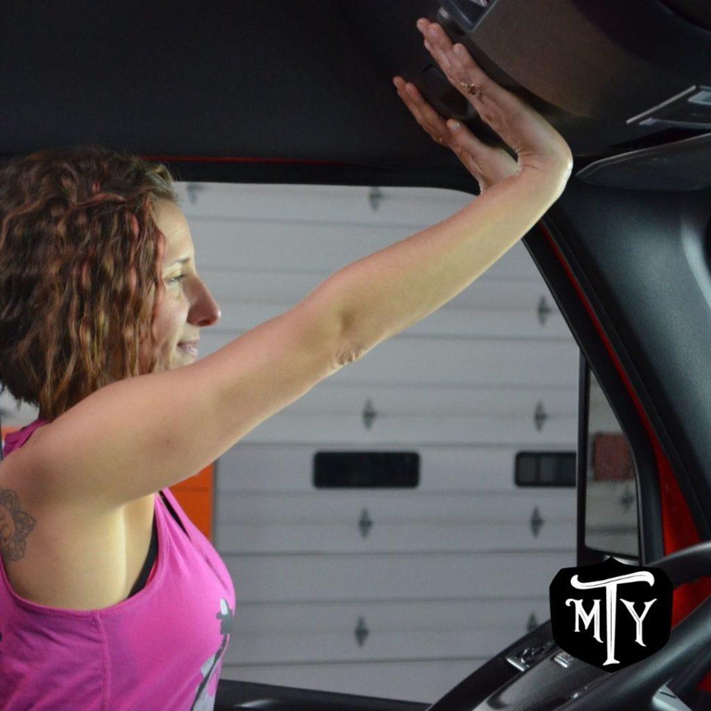 Wrist Stretch in truck mother trucker yoga